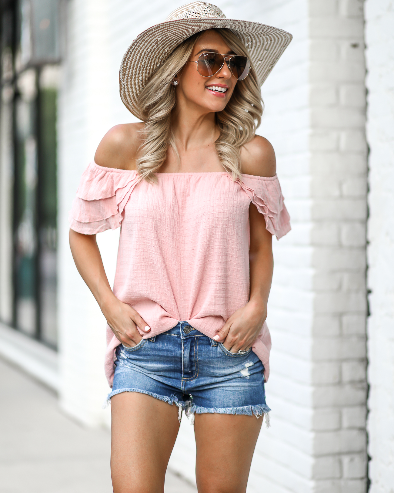 Summer Shorts Outfits Denim Shorts Under $50 Steven Greece Slides Pink Ray Ban Sunglasses White Floppy Hat Pink Off the shoulder top