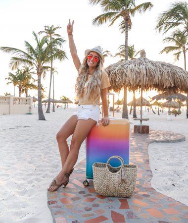 Aruba Travel vlog travel outfit Cal-pak rainbow luggage