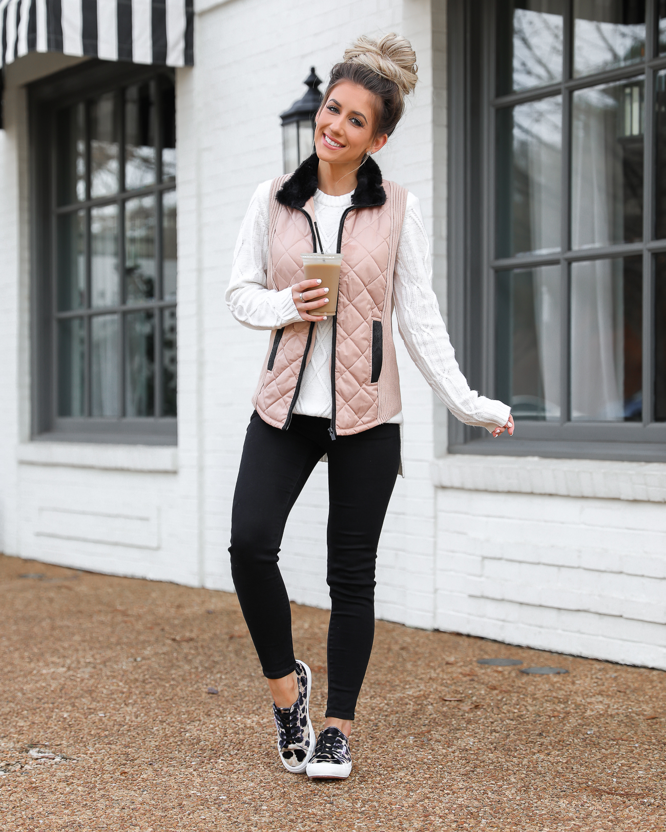 Walmart Tan and Black Quilted Vest Superga leopard velvet sneakers Black skinny jeans White knit tunic sweater Lord & Taylor Laura Beverlin