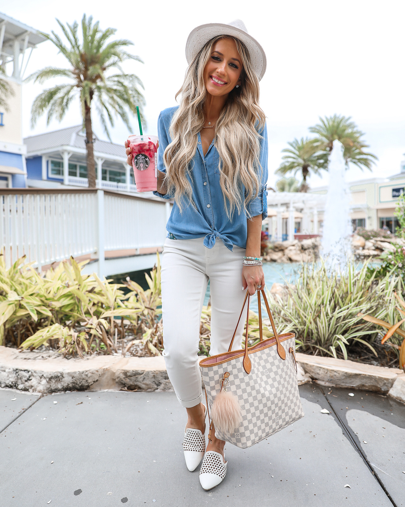 walmart Comfy Casual Florida Outfit White skinny jeans Chambray button up top White mules Louis Vuitton Neverfull MM Starbucks Pink Drink Laura Beverlin-1