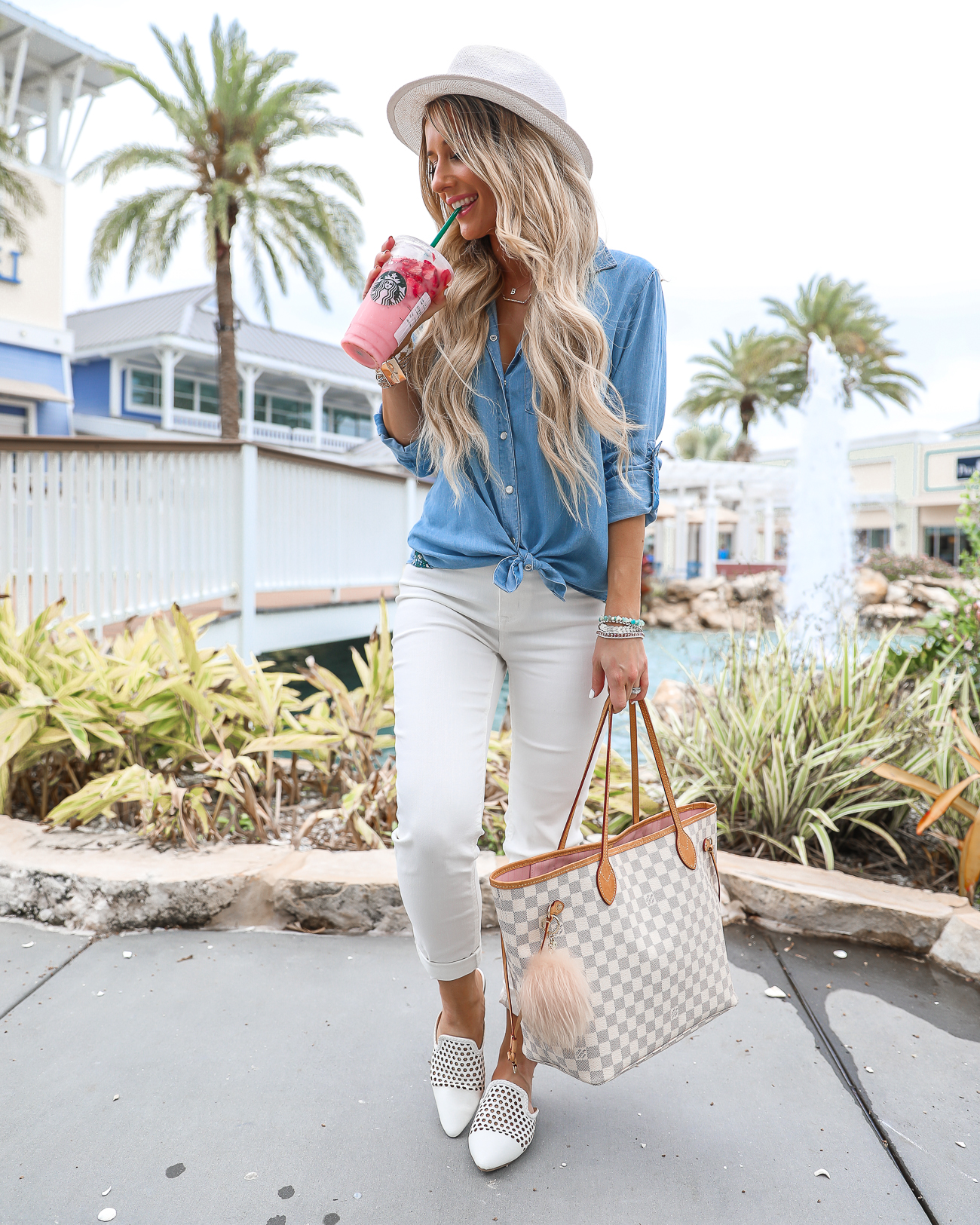 walmart Comfy Casual Florida Outfit White skinny jeans Chambray button up top White mules Louis Vuitton Neverfull MM Starbucks Pink Drink Laura Beverlin-10