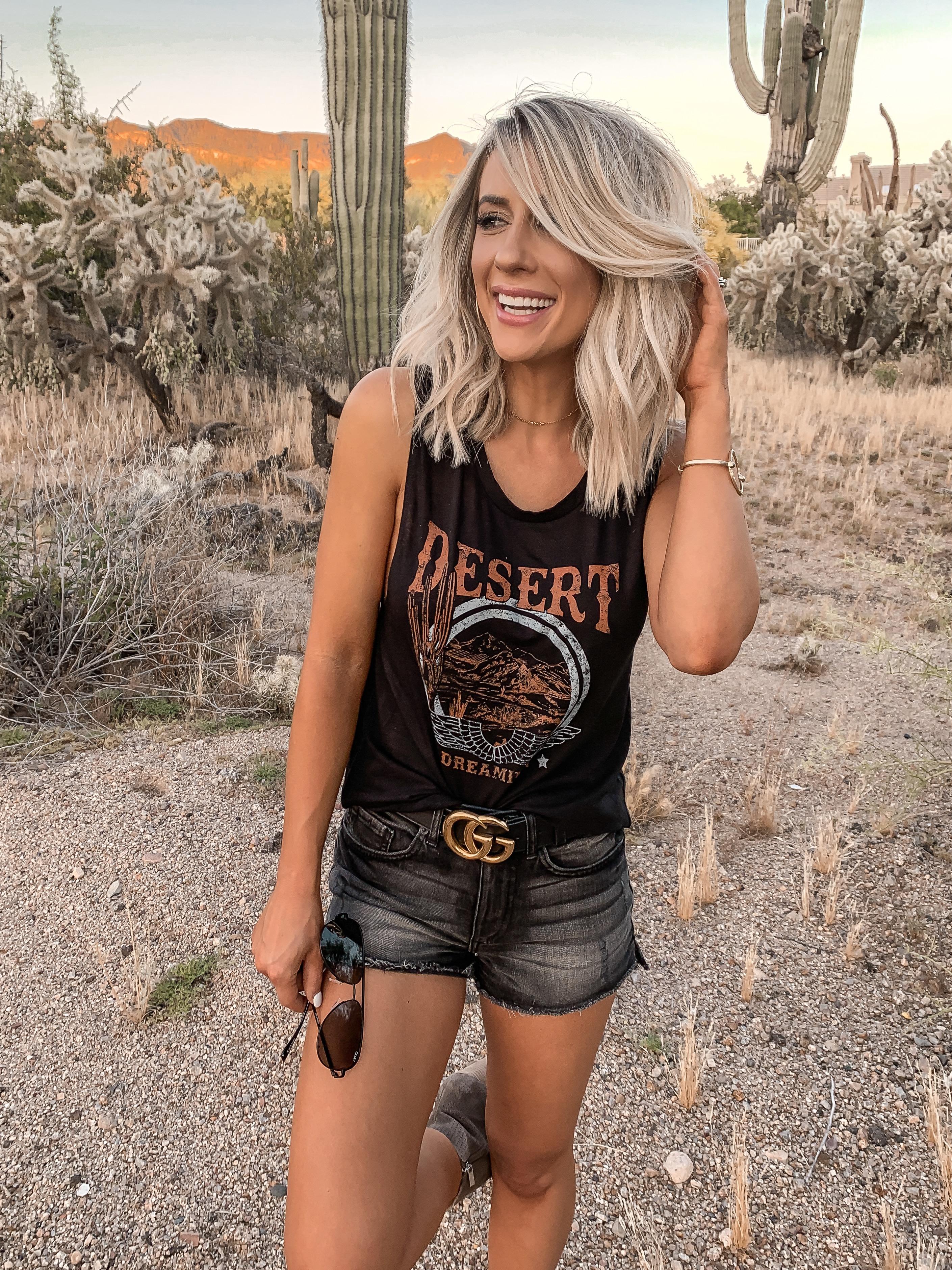 Coachella Stagecoach Festival concert outfit idea black desert outfit black gucci belt Laura Beverlin Short blonde Hair