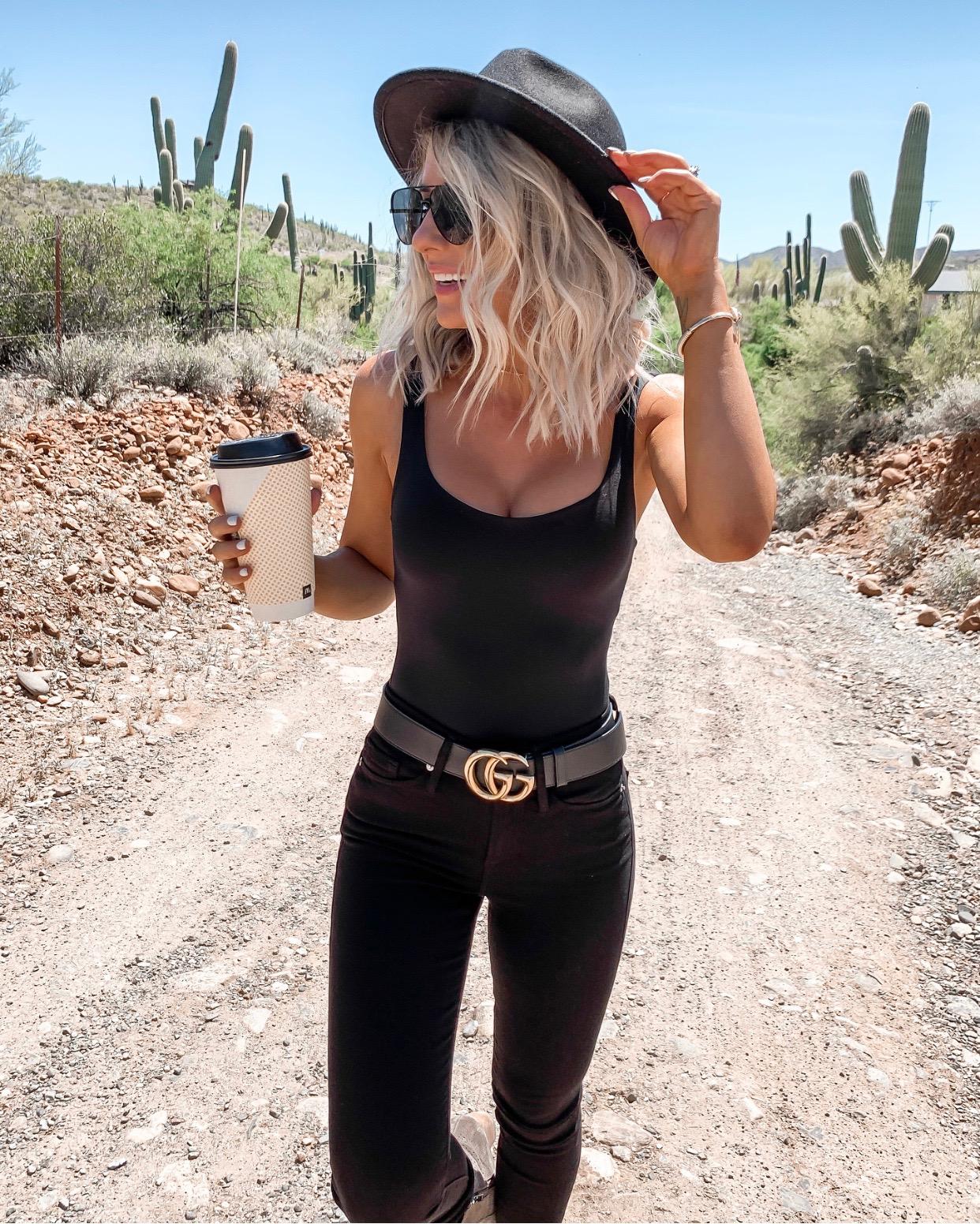 Coachella Stagecoach Festival concert outfit idea black desert outfit black gucci belt all black date night Laura Beverlin Short blonde Hair