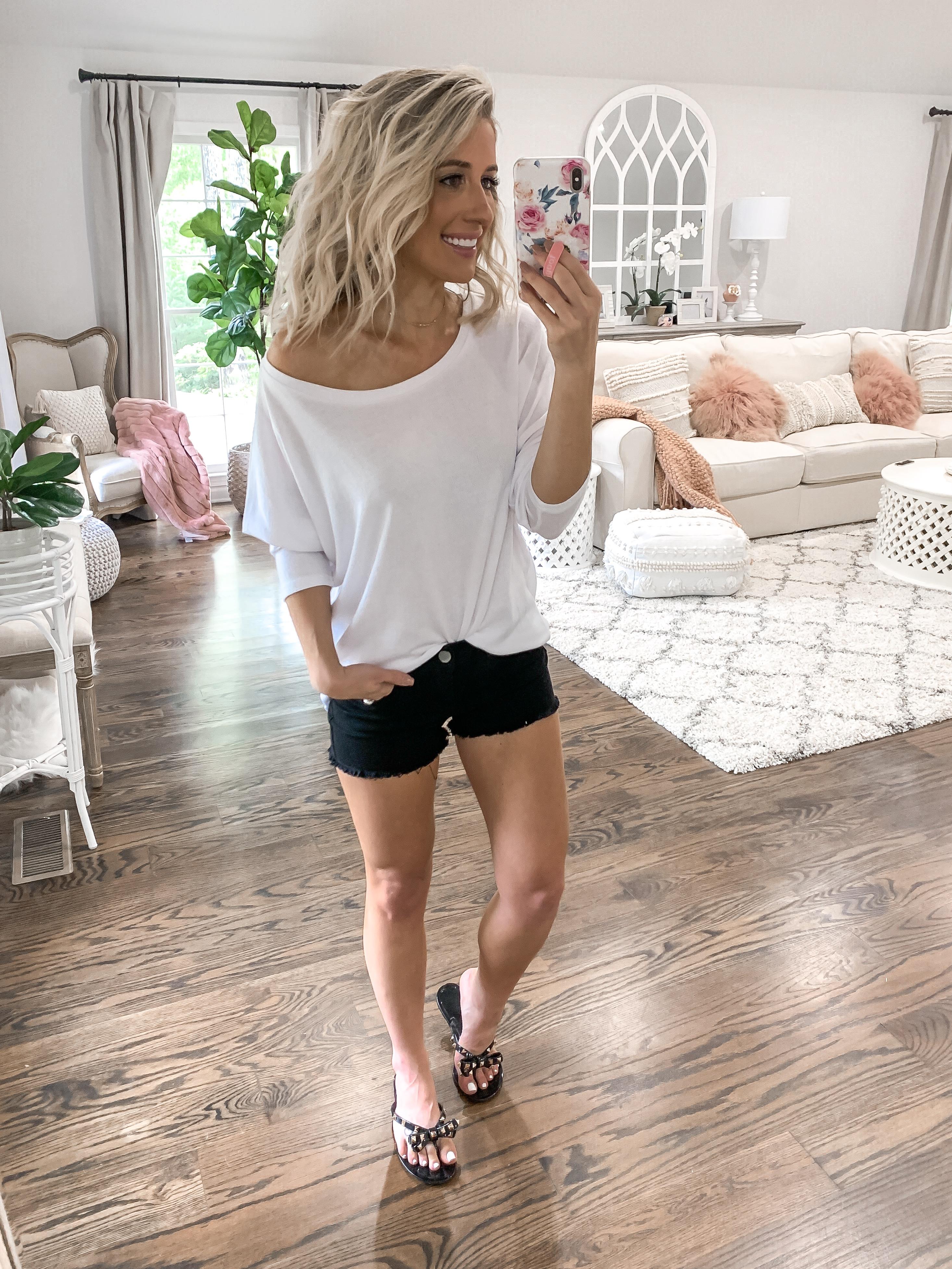 summer finds under $25 black cut off shorts white beach pullover sweatshirt top blonde hair laura beverlin