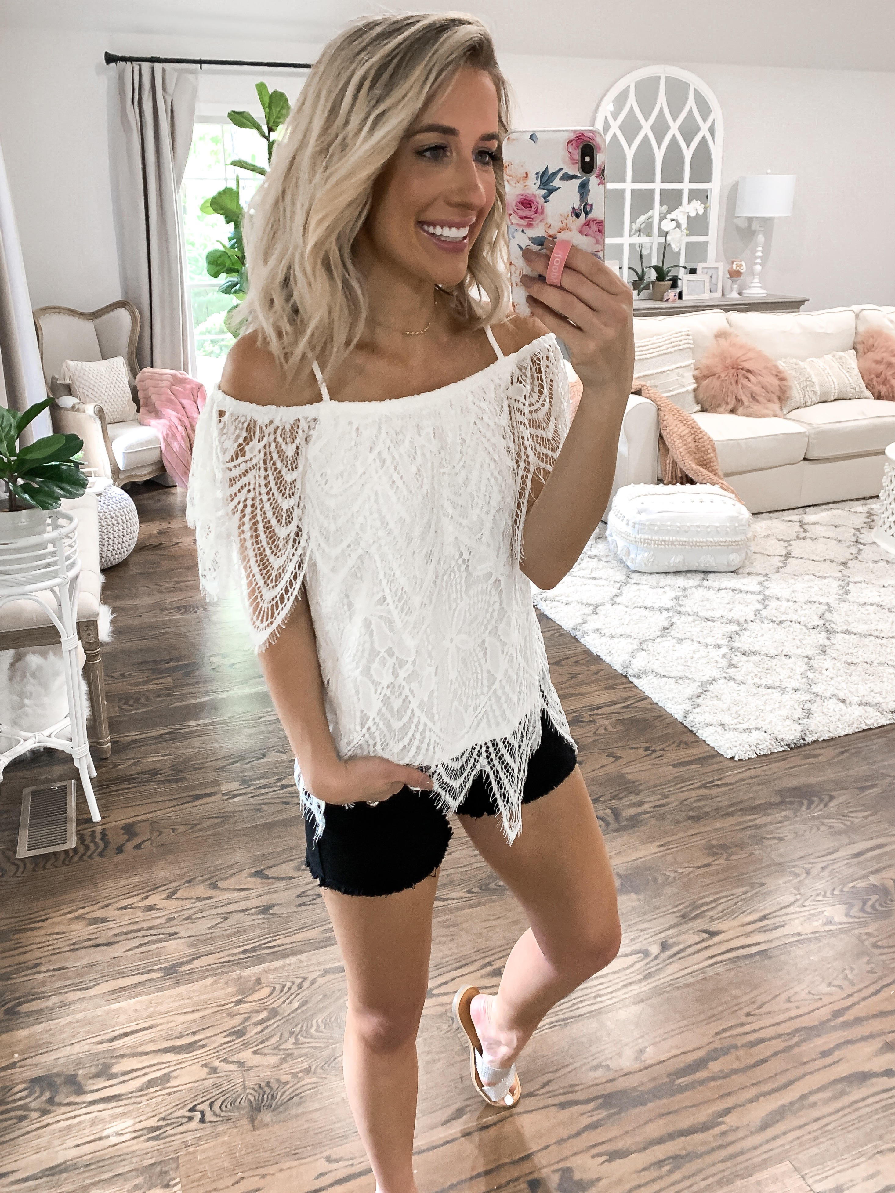 summer finds under $25 black cut off shorts white lace boho top blonde hair laura beverlin