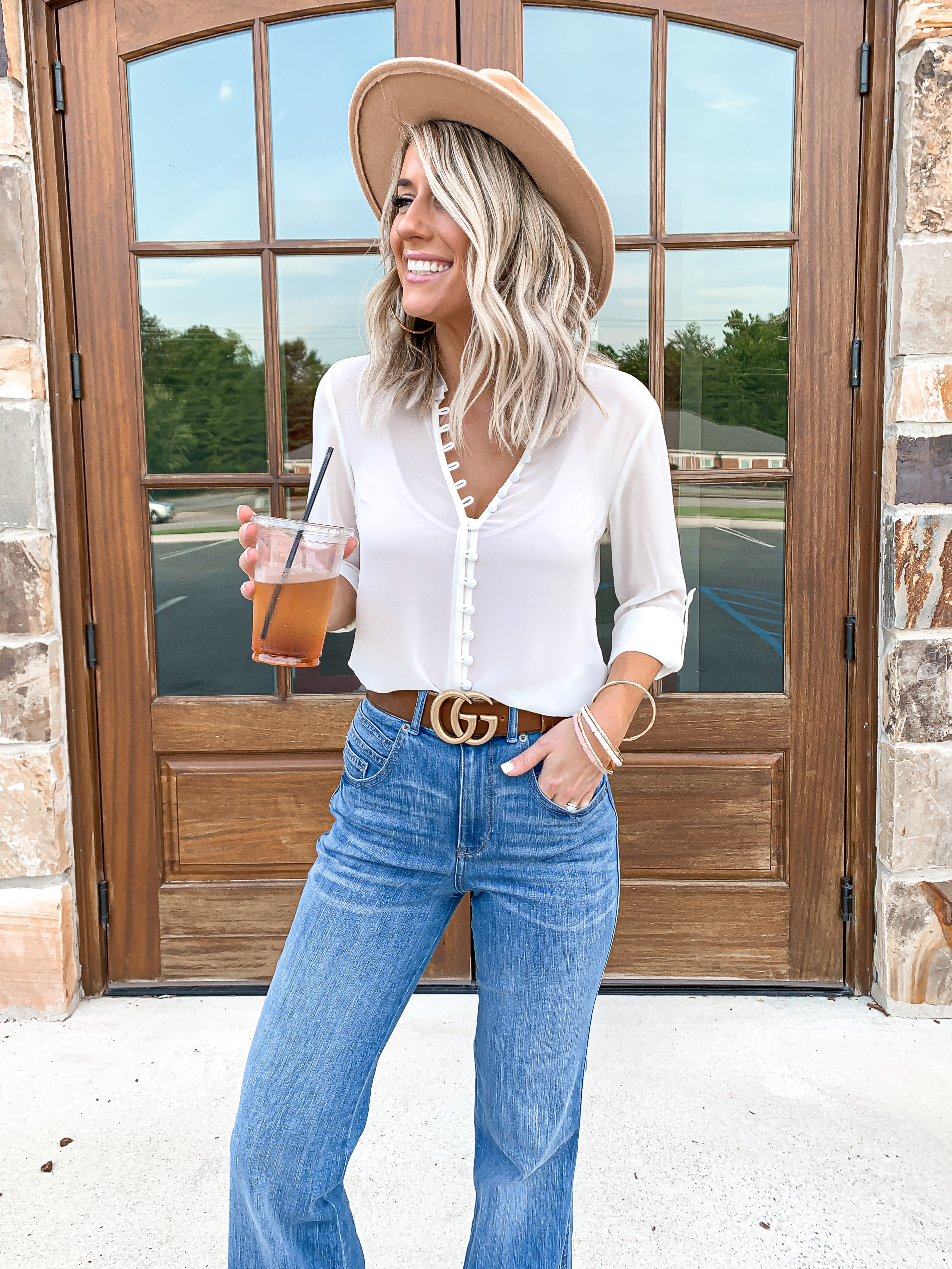 CLASSIC BOHO STYLE WHITE BUTTON DOWN TOP BLUE FLARE JEANS OUTFIT LAURA BEVERLIN BROWN GUCCI BELT19