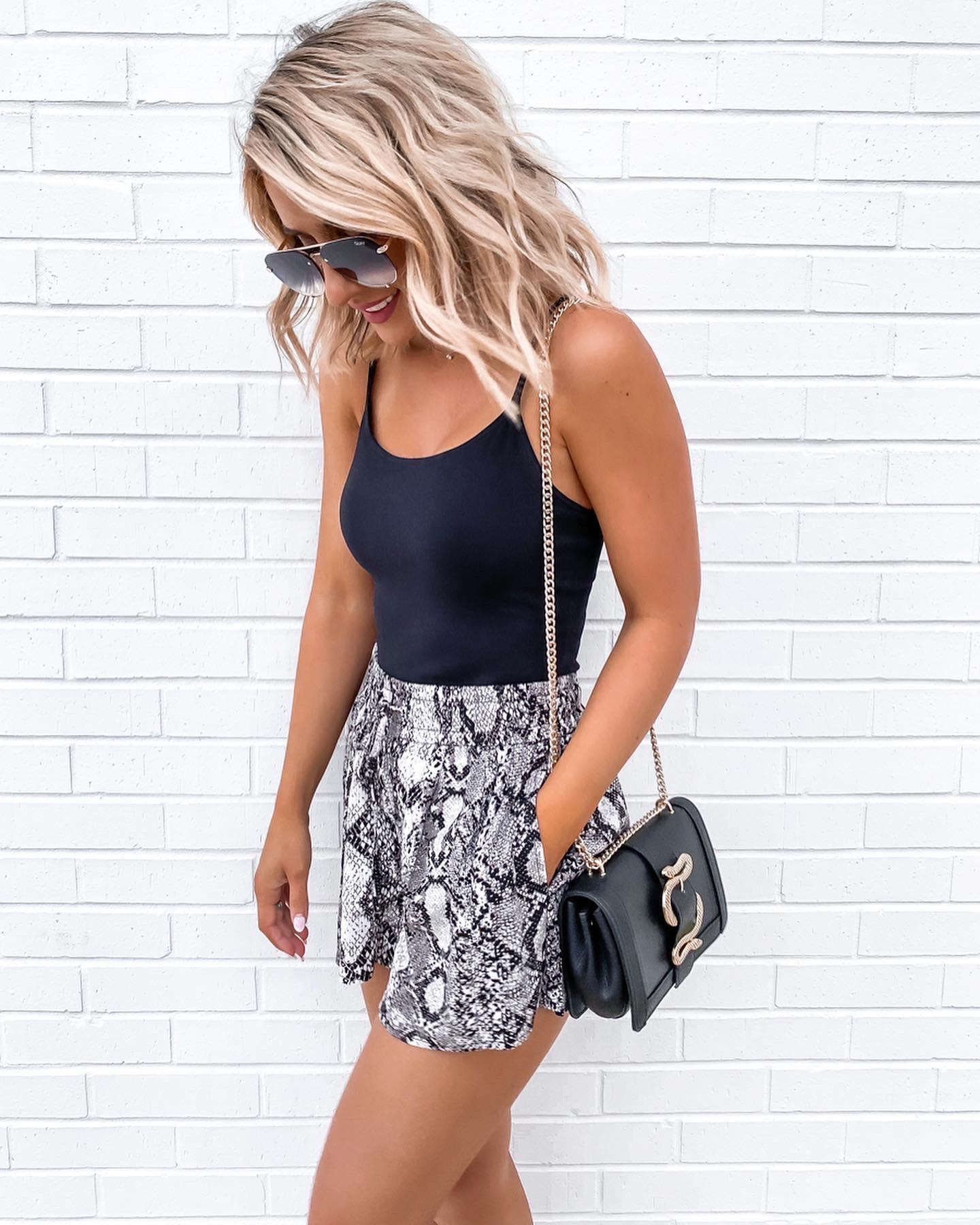 Laura Beverlin Day to night outfit snakeskin shorts black cami black blazer snake crossbody bag3