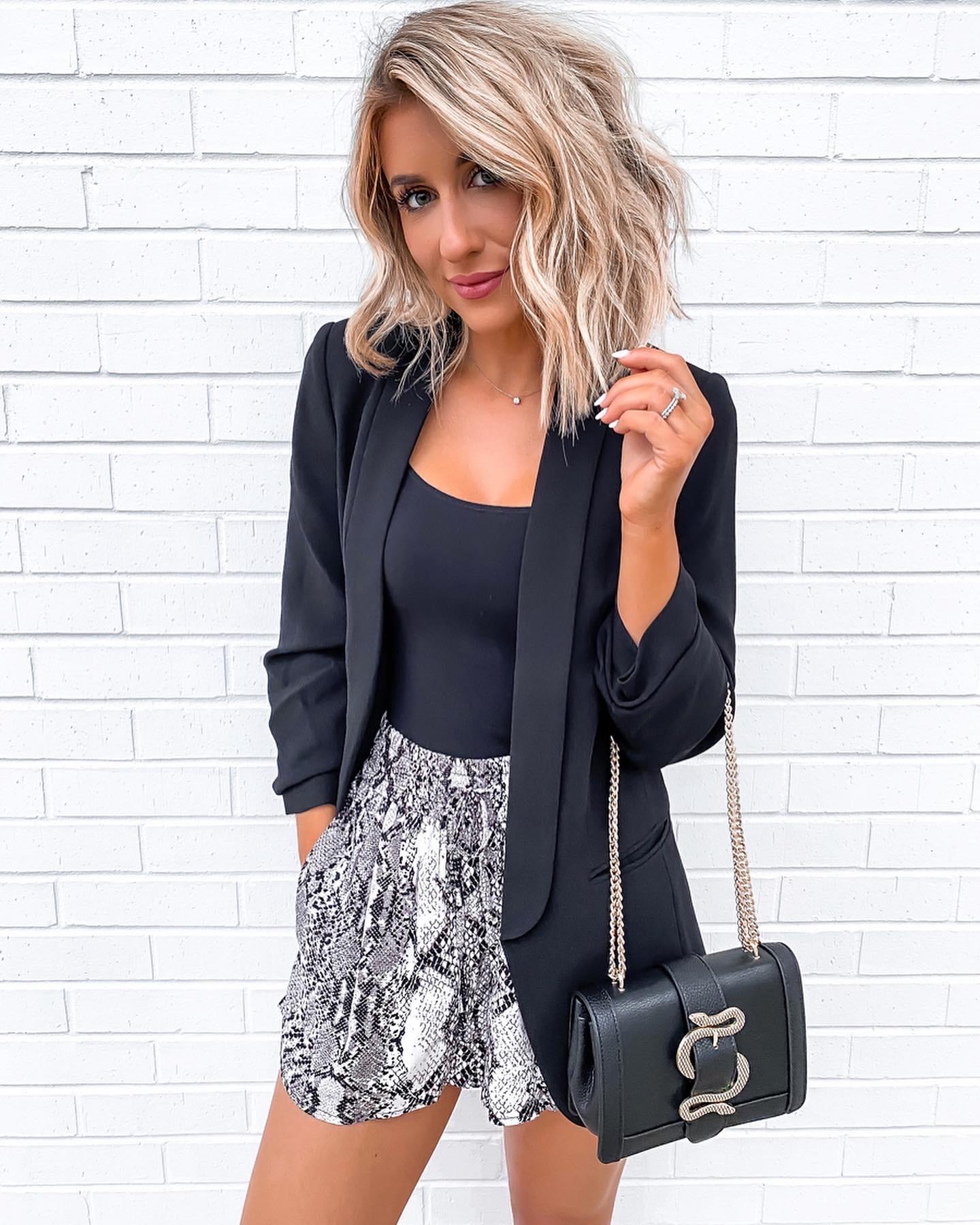 Laura Beverlin Day to night outfit snakeskin shorts black cami black blazer snake crossbody bag2