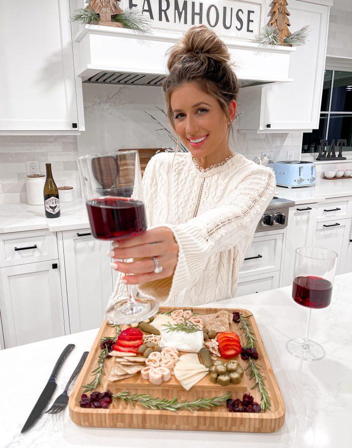 Laura Beverlin Christmas New Years Charcuterie board Wine glasses2